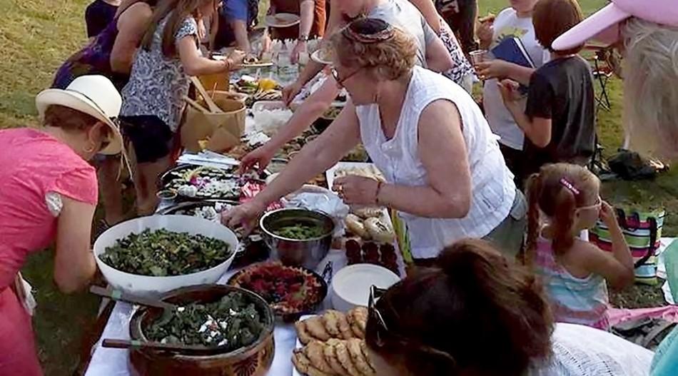 KHN members enjoy potluck-style food alongside Alki beach